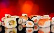 Delicious sushi on shiny blur background
